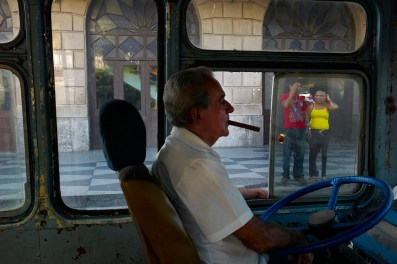 Bus driver waiting for passengers at the train station in Centro Habana. November, 2013