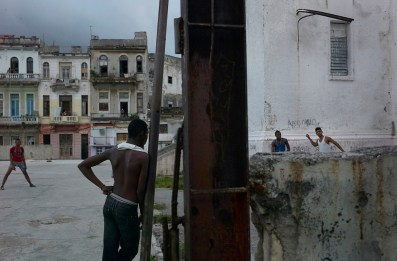 Teenagers playing baseball outside their high school. Centro Habana, November 2013.