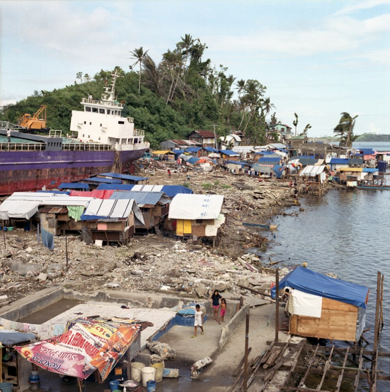 Anibong was almost completely destroyed during the typhoon. Six container ships have been swept to shore which are still seen waiting to be removed from the ground. Meanwhile local people started to rebuild their homes from materials found among the debris. 6 January 2014
