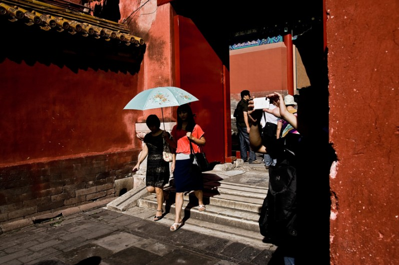 Beijing, Chinese tourists inside the Forbidden City.