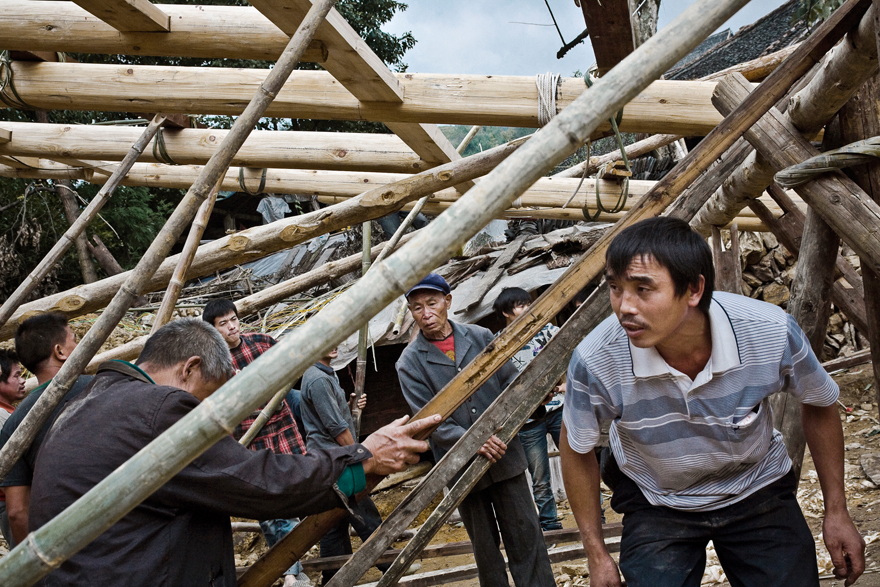 Zhongliu village, construction works of a traditional wood house.