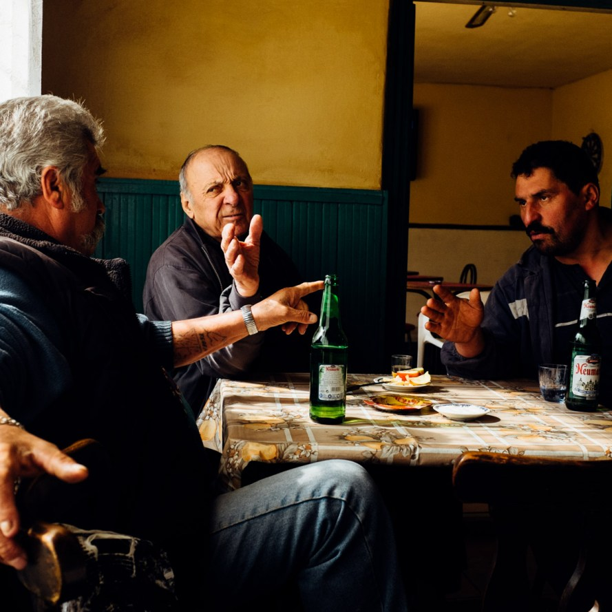 Old mine workers drink and argue in a bar at around 10 in the morning in Petrosani, Romania.