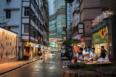 During Ramadan, a group of Muslim men break their fast with an Iftar meal behind Chungking Mansions.