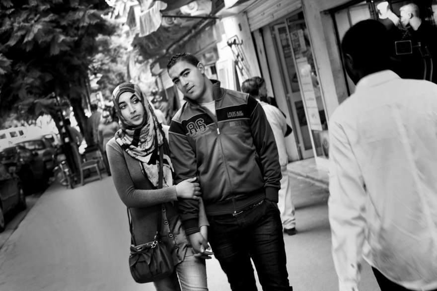 Couple walks at the street in Tunis
