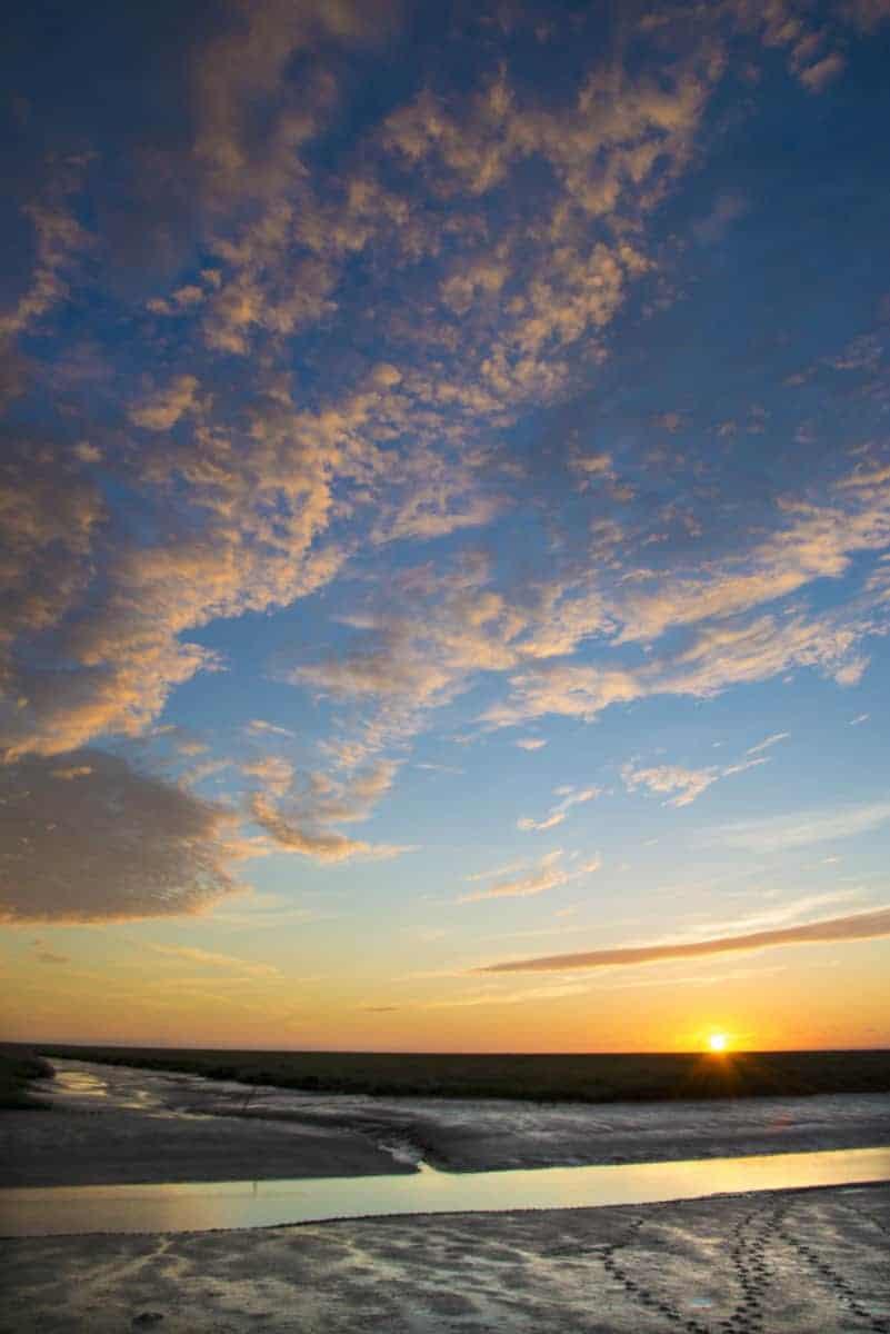 Noordpolderzijl bij zonsondergang