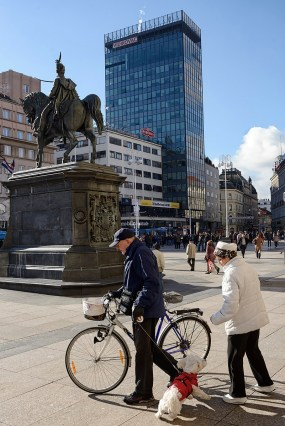 ZAGREB, CROATIA - 2 FEBRUARY, 2014: An elderly couple and their cute dog at the Ban Jelacic Square in Zagreb, Croatia.