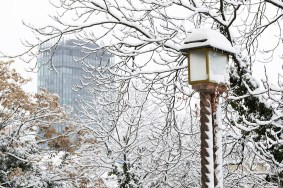 A winter view of a lantern on upper town Zagreb with a skyscrape