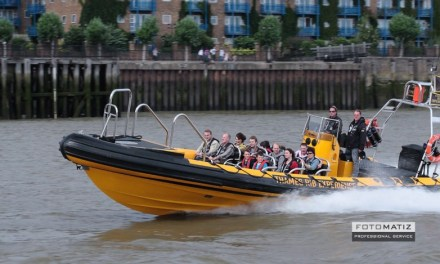 Tourists speedboat on the Thames in London