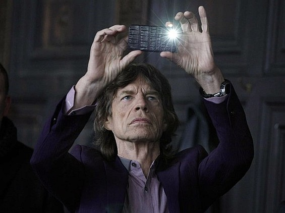 Mick Jagger and an Iphone 4