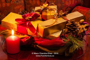 Christmas - gifts, gold boxes, ribbons, pine cone and candle.