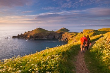 Walkers on the South West Coast Path overlooking the Rumps, Nikon D800E, 17-35mm at 20mm, ISO 200, 0.4 sec at f/11. June. © Adam Burton