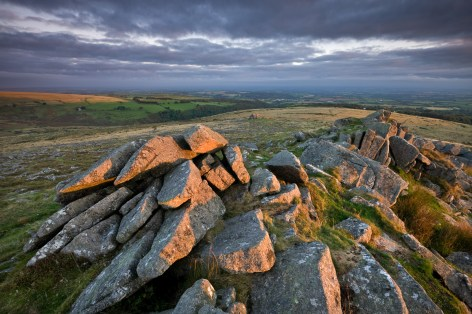 Early morning sunlight lights up the granite rocks of Belstone Tor, Dartmoor, Devon. Autumn. © Adam Burton