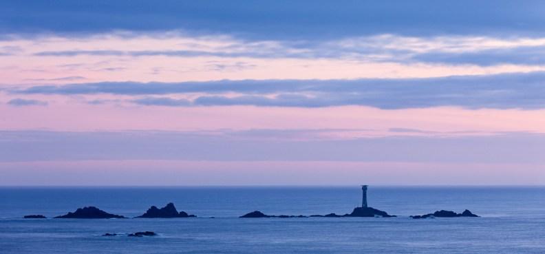 Longships Lighthouse at twilight, Land's End, Cornwall, England. © Adam Burton