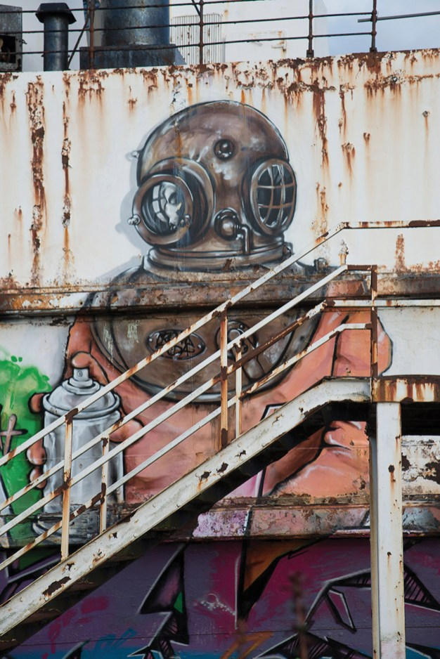 Graffiti artists work on the Duke of Lancaster Steamer. Dee Estuary. Nikon D800, 24-120 at 55mm, 1/125 sec @ f/8, ISO 100
