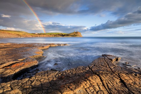 Rainbow over Kimmeridge Bay looking toward Clavell's Tower from the western ledges.
