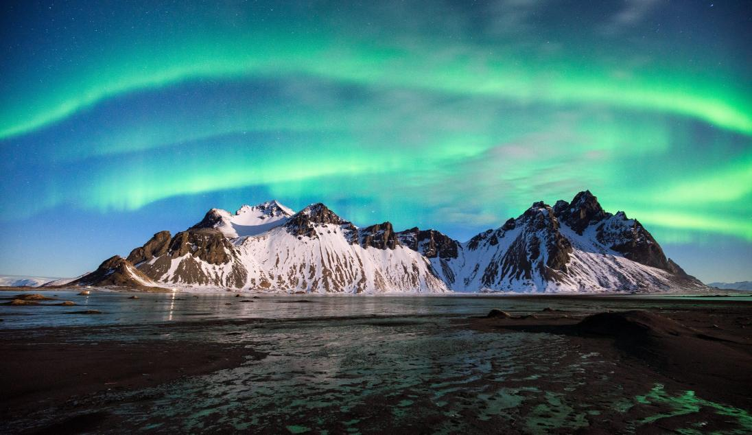 The Vestrahorn (a 454m/1490ft high mountain) at Stokksnes, and the Aurora, Iceland. Sony A7R, Canon 16-35mm F4 L IS, ISO 1600, 13s, F4, tripod, February. © Andrew Yu.