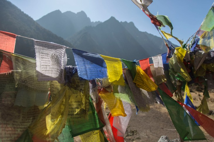 Prayer flags on a small hilltop temple. Canon 5D MkIII, 24-105mm at 24mm, ISO 100, 1/800 sec at f/4. © Stuart Holmes.