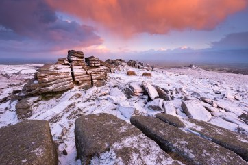 Colourful sunrise at Belstone Tor, Dartmoor. Nikon D800E, Nikon 17-35mm at 17mm, ISO 100, 0.6s at f/13, January. Tripod. © Adam Burton.