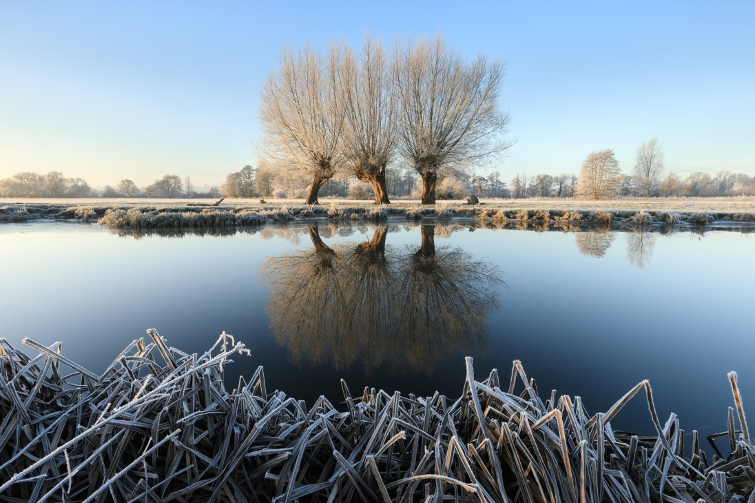 A frostbitten River Stour near Flatford, Suffolk. Canon 5D MkIV, Canon 16-35mm f/2.8 @ 17mm, ISO 100, 1/6s @ f/16, Lee Filters Landscape Polariser, Gitzo Tripod, December. ©Justin Minns/National Trust
