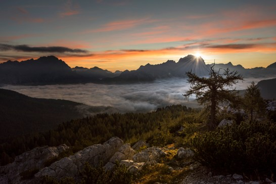 The sun rises behind the Sorapiss group as low cloud fills the Ampezzo basin. Nikon D810, 16-35 at 27mm, ISO 100, 1/100s at f/5, September.©James Rushforth