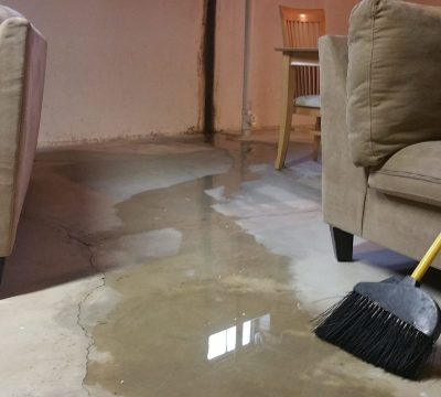 Flooded basement with sofa