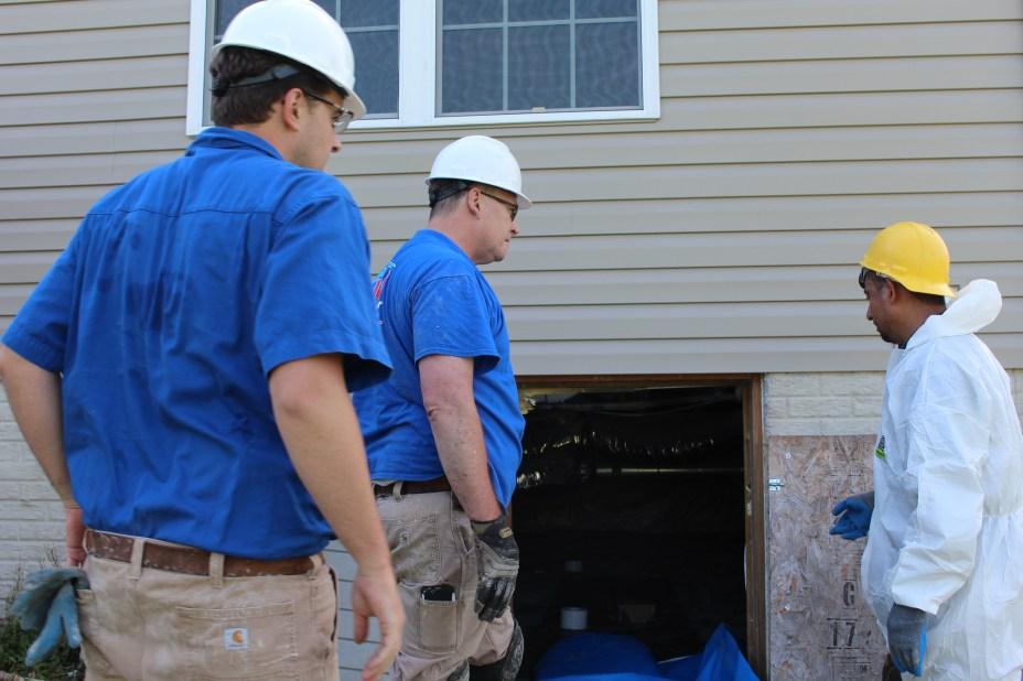 crawl space inspection with crew