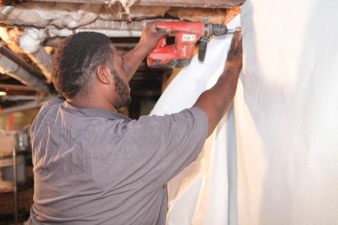Crew installing WallSeal in Basement