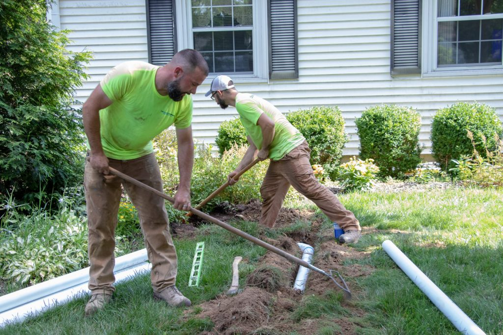 consider buried downspout installation