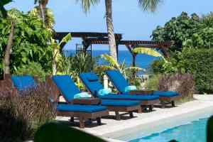 Sit by the pool when you enjoy our vacation rentals in Anguilla