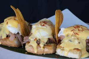 eggs benedict at the straw hat cafe, one of the best restaurants in anguilla
