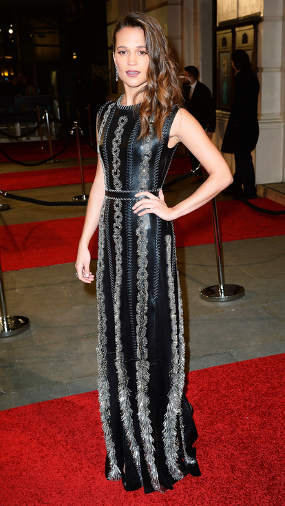 Alicia Vikander black textured Louis Vuitton gown on red carpet