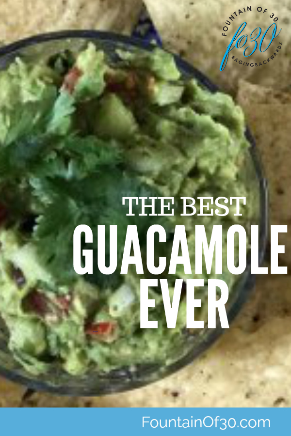 Chunky Guacamole and Chips on a plate.
