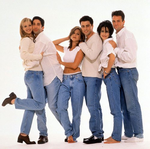 80s style cast of Frieds wearing denim and white shirts