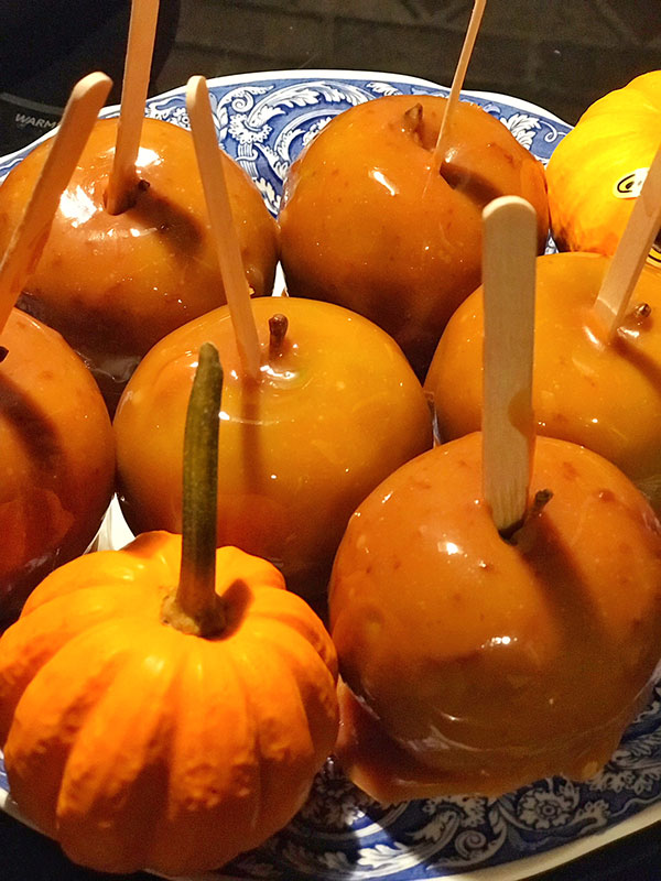salted caramel apples recipe serving on a plate with gourds