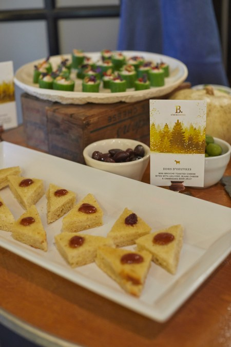 Food on a plate at Beekman 1802 grilled cheese triangles and jam