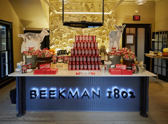Beekman 1802 Goat Poop products on table with neon