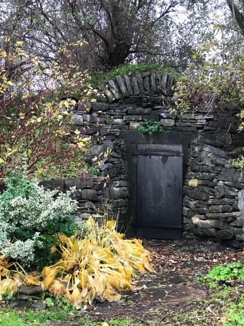 Beekman 1802 Farm Crypt door stone wall and trees