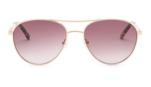 Kerry Washington cozy pastel look rose sunglasses