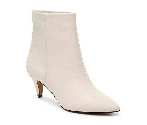 Kerry Washington cozy pastel look winter white boot