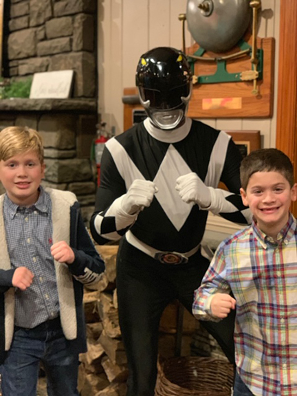 two boys with Power Ranger in black