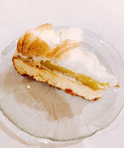 Lemon meringue cheesecake on a plate