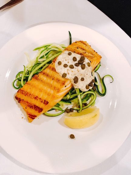 grilled salmon with lemon caper sauce over zucchini noodles