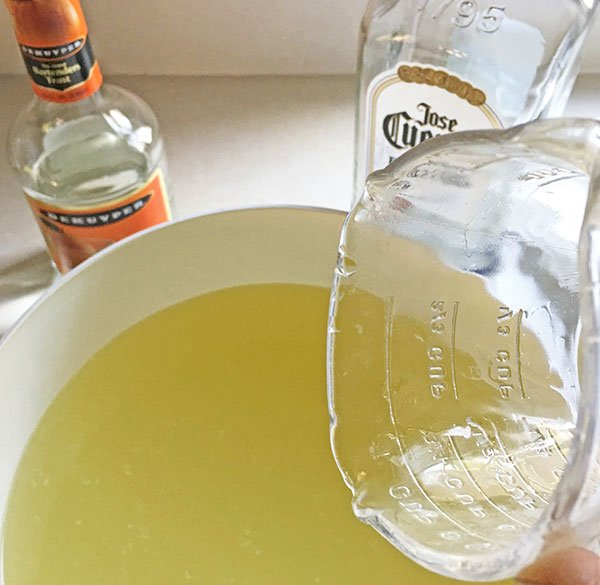 Margaritas For a Crowd mix tequila and triple sec fountainof30