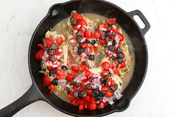 Chicken breast In a Skillet with tomtoes onion black olives