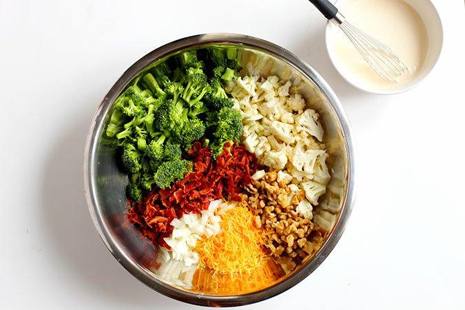 Low Carb Broccoli Cauliflower Salad ingredients in a bowl