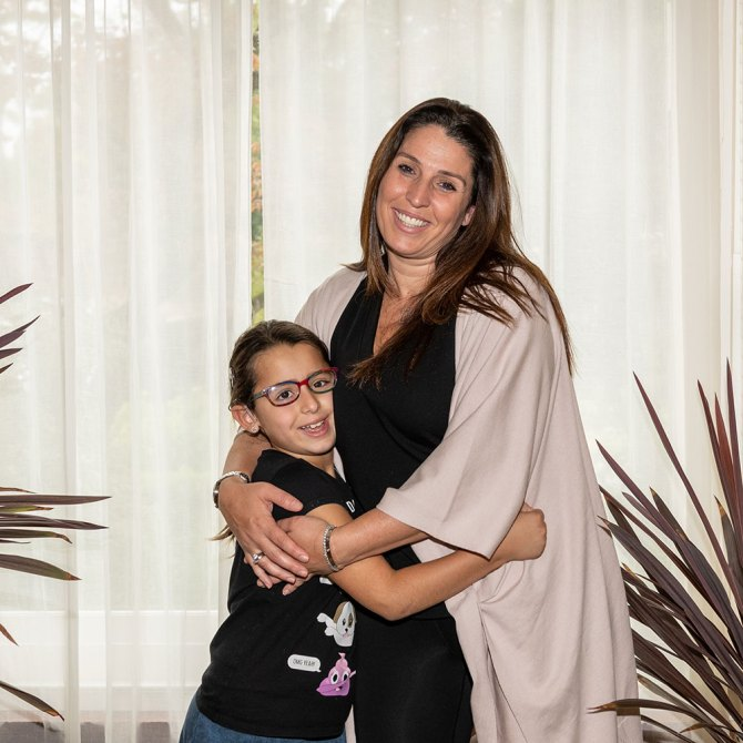 Cochlear Implants child with mother