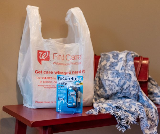 Nicorette Coated Ice Mint Lozenges with Walgreens bag on table