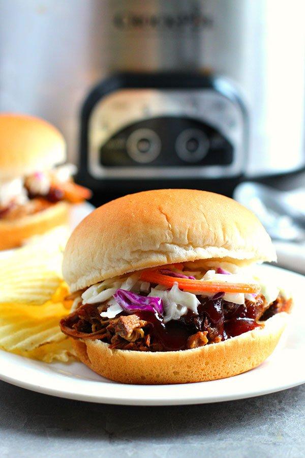Texas-Style Crock-Pot Pulled Pork bun with cole slaw fountainof30