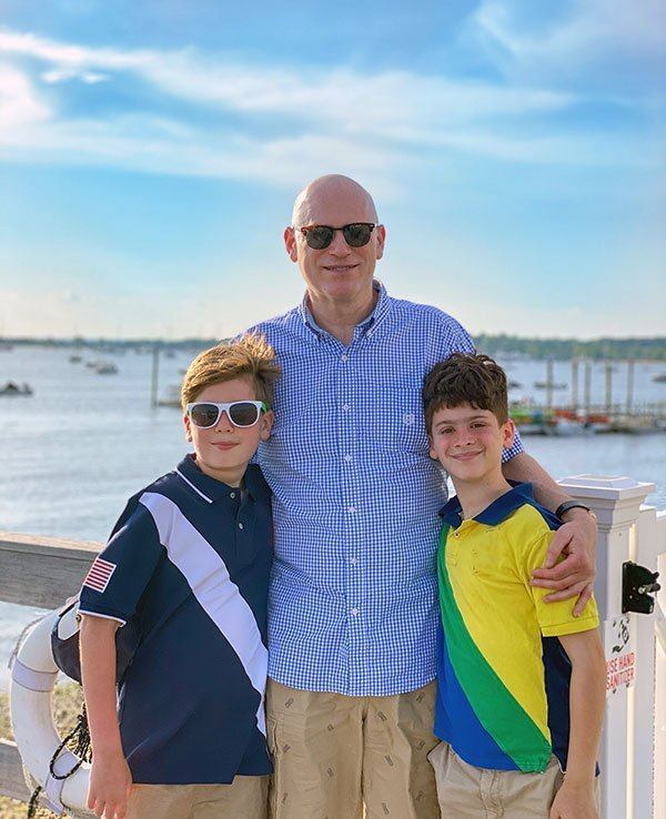 man with 2 sons on vacation fountainof30