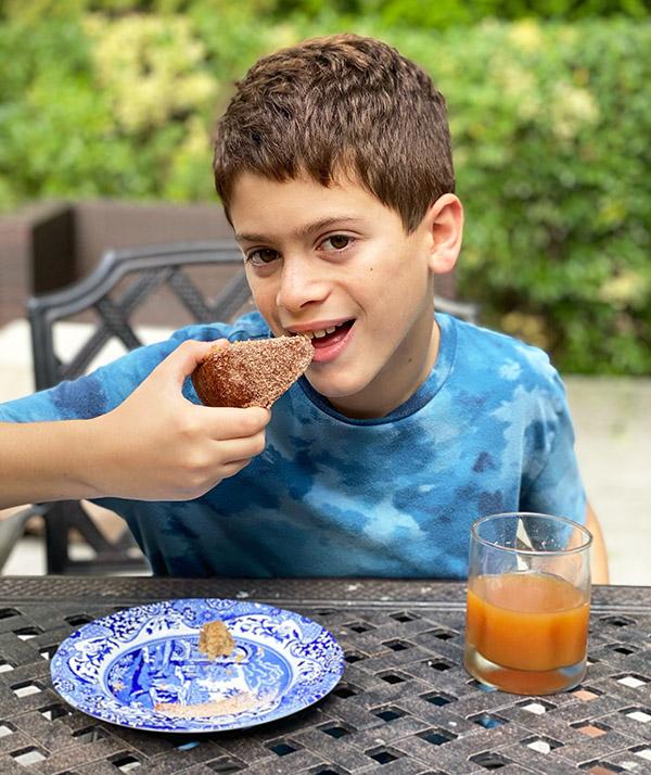 boy eating Apple Cider Cake fountainof30